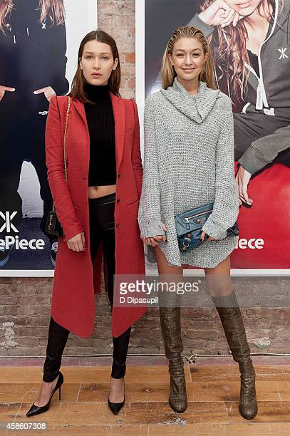 Gigi Hadid and sister Bella Hadid attend the OnePiece New York Concept Store Grand Opening at the OnePiece Concept Store on November 7 2014 in New...