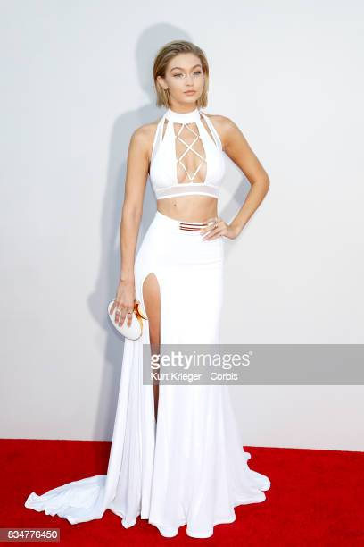 Image has been digitally retouched Gigi Hadid arrives at the 2015 American Music Awards in Los Angeles California on November 22 2015