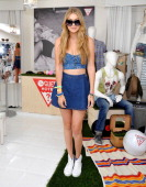 Gigi Hadid attend the GUESS Hotel pool party at Viceroy Palm Springs on April 13 2013 in Palm Springs California