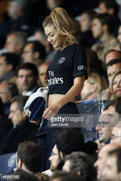 Gigi Hadid attends the French Ligue 1 match between Paris SaintGermain FC and Olympique de Marseille at Parc des Princes stadium on October 4 2015 in...