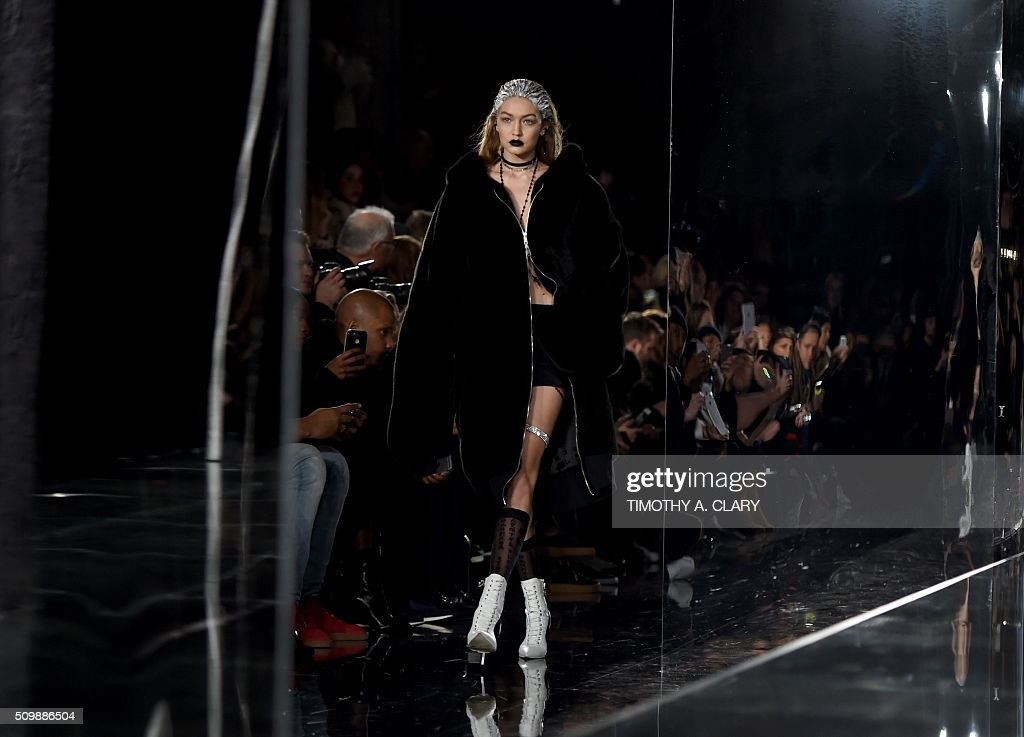 Gigi Hadid displays fashions during the Fenty PUMA by Rihanna show during the Fall 2016 New York Fashion Week in New York on February 12, 2016. / AFP / Timothy A. CLARY