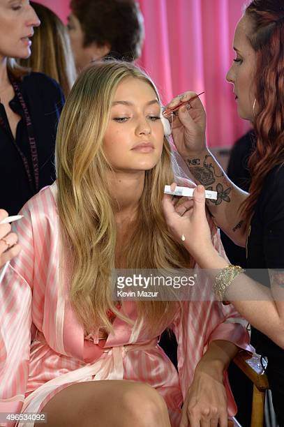 Gigi Hadid gets ready backstage before the 2015 Victoria's Secret Fashion Show at Lexington Armory on November 10 2015 in New York City