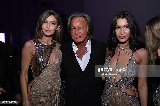 Gigi Hadid Mohamed Hadid and Bella Hadid attend the Victoria's Secret After Party at the Grand Palais on November 30 2016 in Paris France