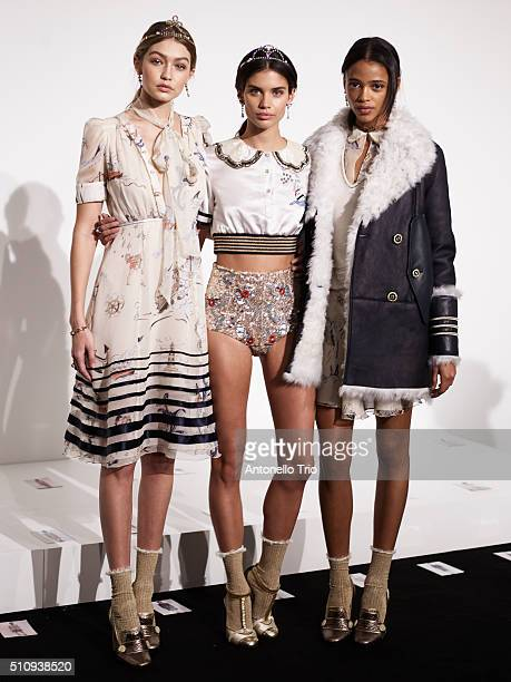 Gigi Hadid poses with models backstage at the Tommy Hilfiger Women's Fall 2016 show during New York Fashion Week The Shows at Park Avenue Armory on...
