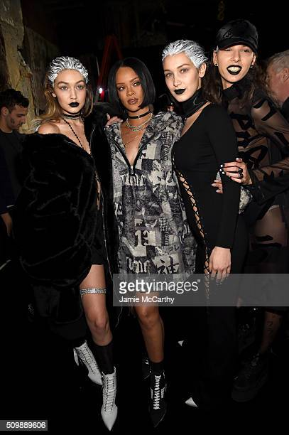 Gigi Hadid Rihanna and Bella Hadid attend the FENTY PUMA by Rihanna AW16 Collection during Fall 2016 New York Fashion Week at 23 Wall Street on...