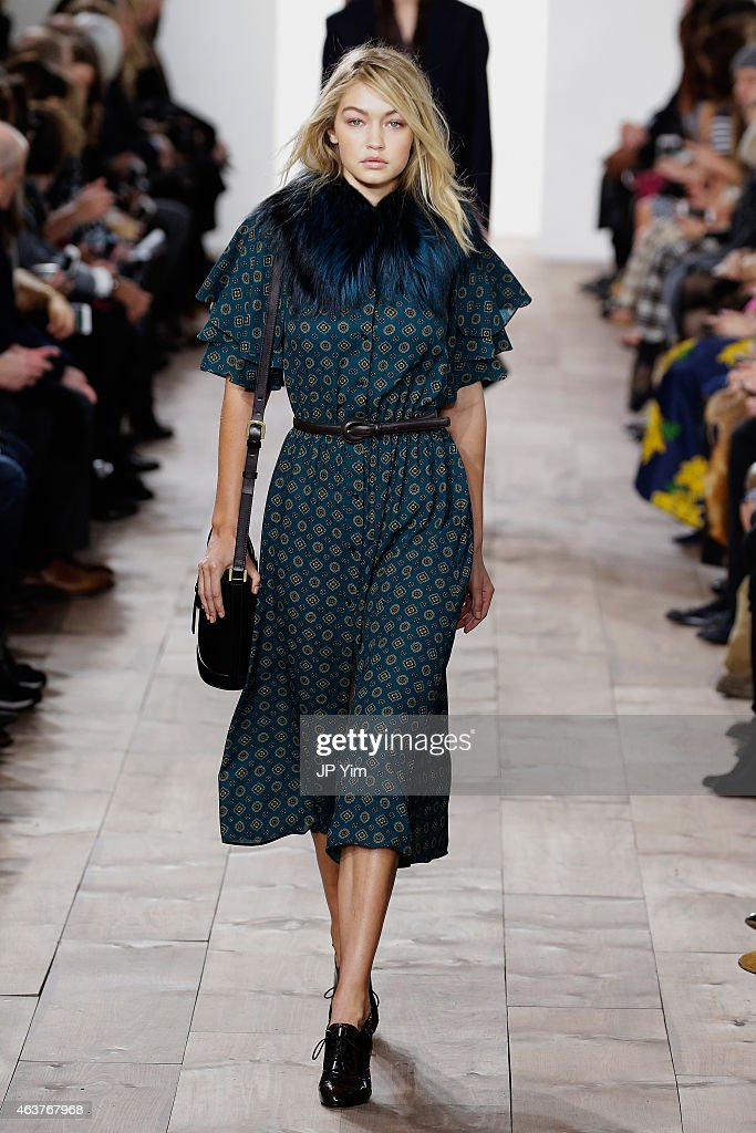 Gigi Hadid walks the runway at the Michael Kors fashion show during MercedesBenz Fashion Week Fall at Spring Studios on February 18 2015 in New York...