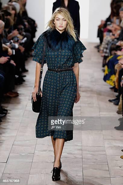 Gigi Hadid walks the runway at the Michael Kors fashion show during MercedesBenz Fashion Week Fall at Spring Studios on February 18 2015 in New York...