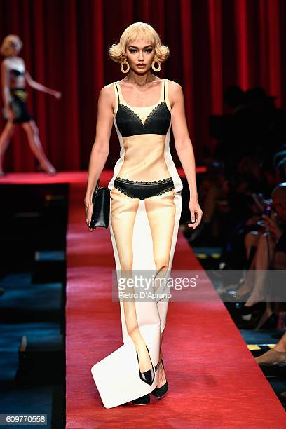 Gigi Hadid walks the runway at the Moschino show during Milan Fashion Week Spring/Summer 2017 on September 22 2016 in Milan Italy