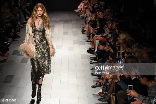 Gigi Hadid walks the runway for Anna Sui fashion show during New York Fashion Week The Shows at Gallery 1 Skylight Clarkson Sq September 11 2017 in...