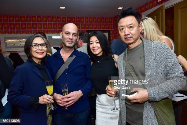 GiGi Salomon Paul Robinson Lydia Duanmu and Li Wang attend the launch of The Collector Geneva's Sophie Bonvin Code Collection in Collaboration with...