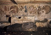 Giglioli tomb with a fresco depicting spears swords and shields above the sarcophagus Etruscan necropolis of Tarquinia Lazio Italy 4th century BC