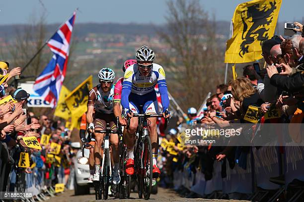 Gijs Van Hoecke of Belgium and Topsport Vlaanderen Baloise leads the peloton up the Oude Kwaremont during the 100th edition of the Tour of Flanders...