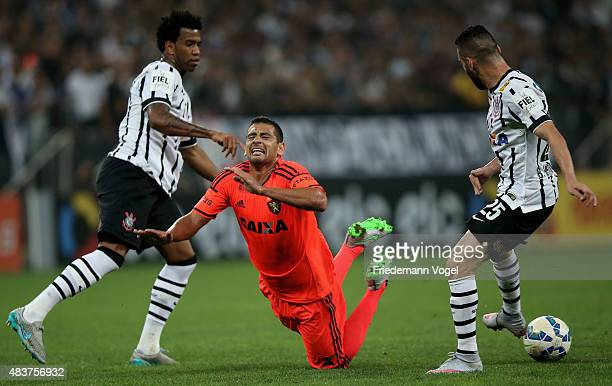 Gil and Bruno Henrique of Corinthians fights for the ball with Diego Souza of Sport during the match between Corinthians and Sport Recife for the...