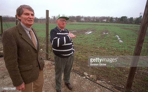 Gil Griggs right shows USDA Deputy Secretary Richard Rominger left part of the 31 acres of farm land he was a leader of in protecting next to his farm