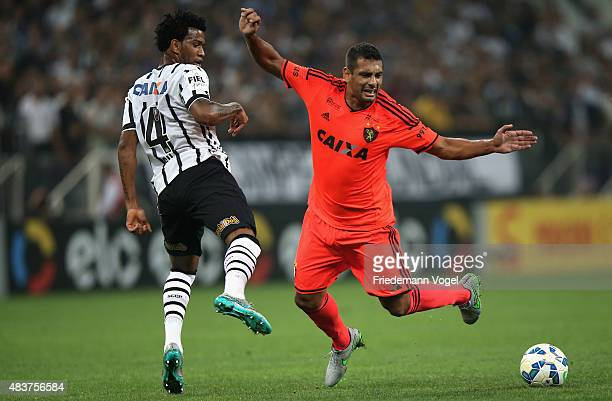 Gil of Corinthians fights for the ball with Diego Souza of Sport during the match between Corinthians and Sport Recife for the Brazilian Series A...