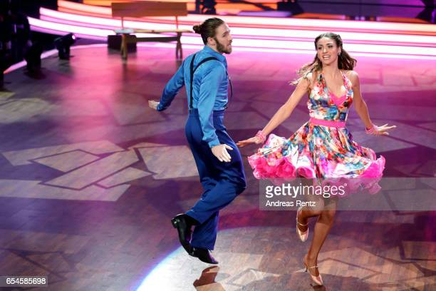 Gil Ofarim and Ekaterina Leonova perform on stage during the 1st show of the tenth season of the television competition 'Let's Dance' on March 17...