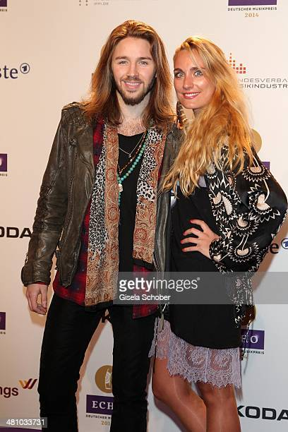 Gil Ofarim and his girlfriend Verena Brock poses on the red carpet prior the Echo award 2014 at Messe Berlin on March 27 2014 in Berlin Germany