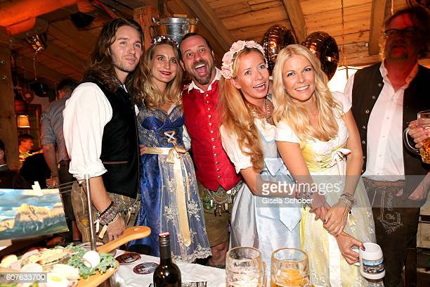 Gil Ofarim and his wife Verena Ofarim Michel Guillaume and his wife Georgia Guillaume and Tina Kaiser during the 'Almauftrieb' as part of the...