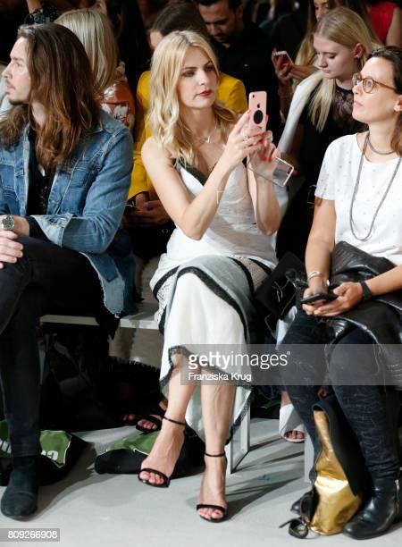 Gil Ofarim and Tanja Buelter attend the Rebekka Ruetz show during the MercedesBenz Fashion Week Berlin Spring/Summer 2018 at Kaufhaus Jandorf on July...