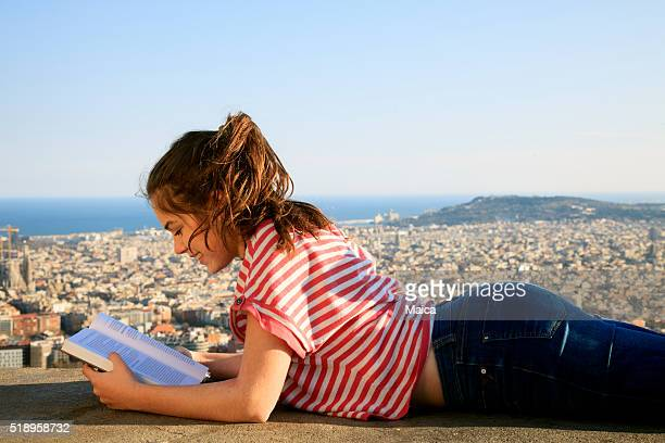 Gil readin on a top of Barcelona