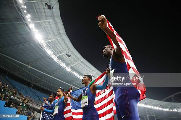 Gil Roberts Arman Hall Tony McQuay and Lashawn Merritt of the United States react after winning gold in the Men's 4 x 400 meter Relay on Day 15 of...