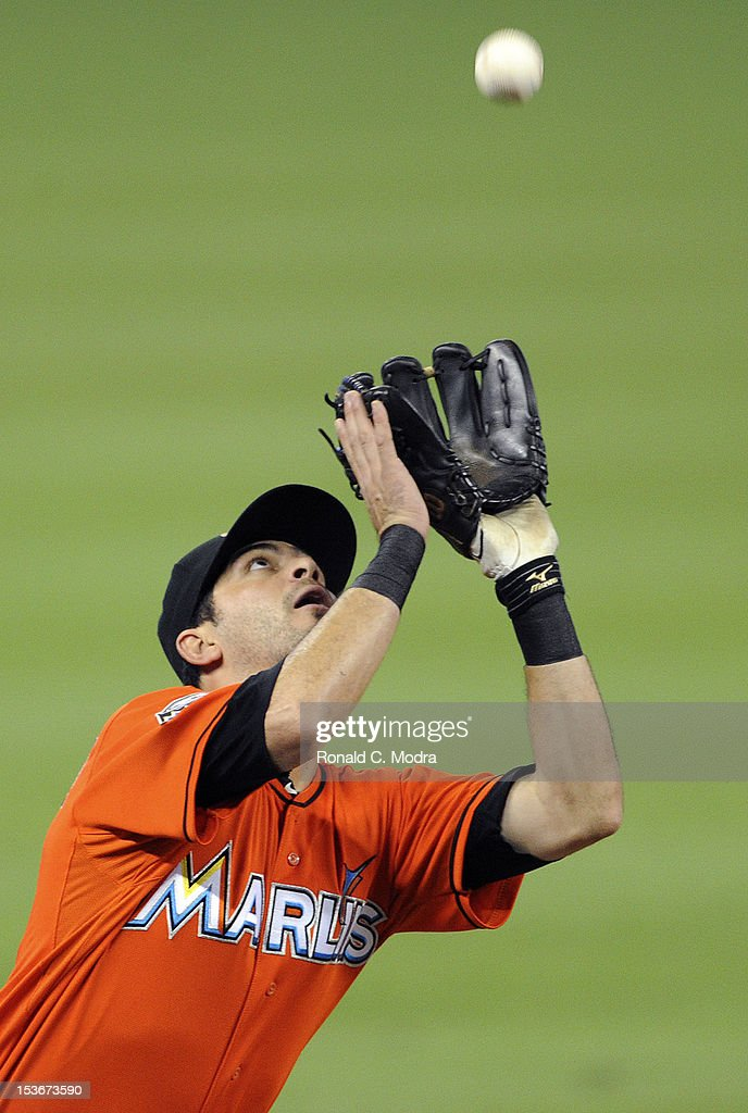 Gil Velazquez #41 of the Miami Marlins catches a ball during a MLB game against the New York Mets at Marlins Park on October 3, 2012 in Miami, Florida.