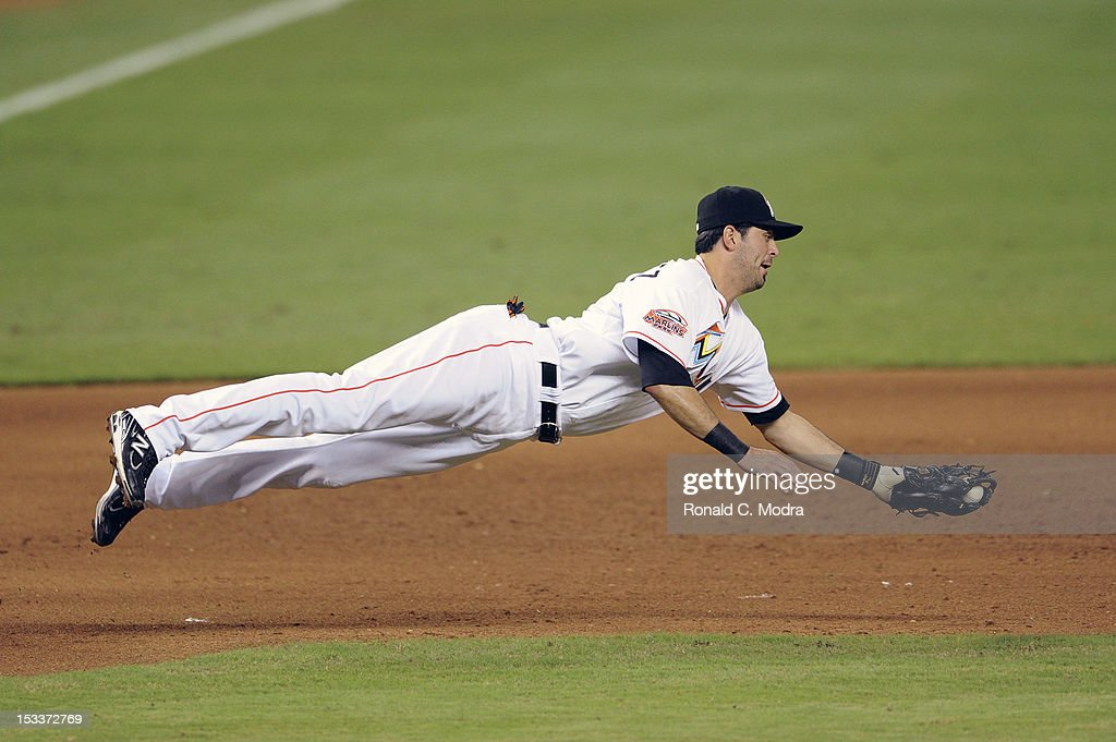 Gil Velazquez #41 of the Miami Marlins dives for a ball during a MLB game against the New York Mets at Marlins Park on October 2, 2012 in Miami, Florida.
