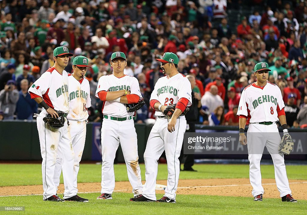 Gil Velazquez #21, Ramiro Pena #19, Luis Cruz #47, Adrian Gonzalez #23 and Edgar Gonzalez #8 of Mexico stand on the field following an on the field altercation against Canada during the World Baseball Classic First Round Group D game at Chase Field on March 9, 2013 in Phoenix, Arizona. Canada defeated Mexico 10-3.
