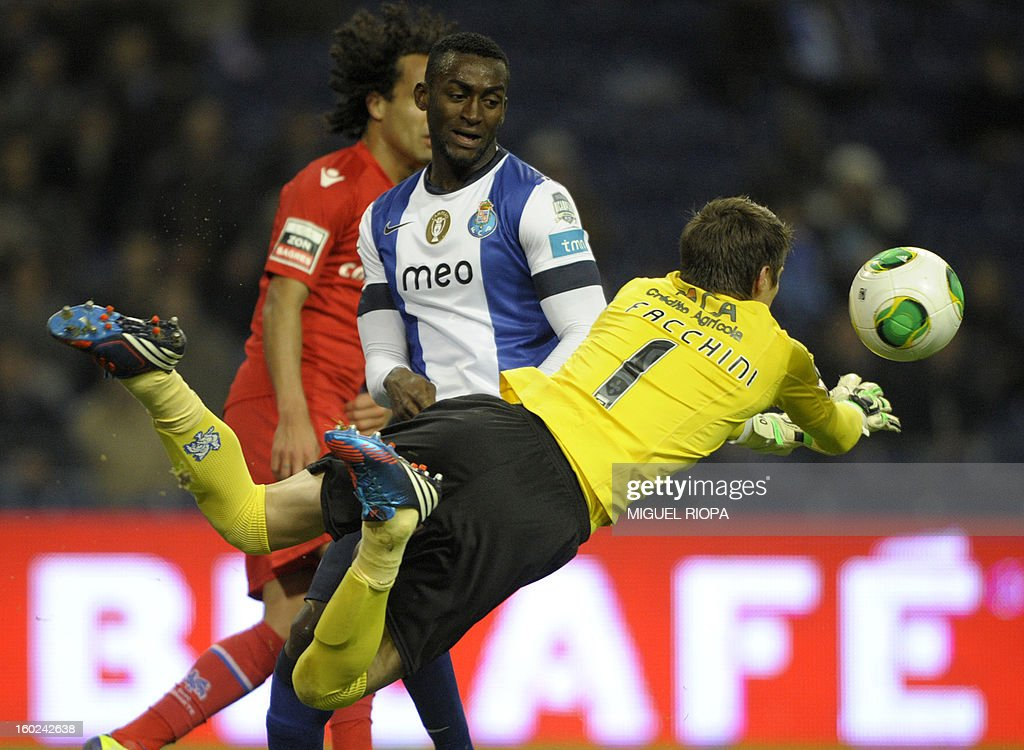 Gil Vicente's Brazilian goalkeeper Adriano Facchini (R) saves a ball next to Porto's Colombian forward Jackson Martinez during the Portuguese league football match FC Porto vs Gil Vicente at the Dragao Stadium in Porto on January 28, 2013.
