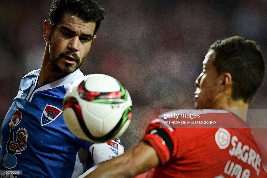Gil Vicentes's midfielder Joao Vilela (L) vies with Benfica's Brazilian forward Rodrigo <a gi-track='captionPersonalityLinkClicked' href=/galleries/search?phrase=Lima+-+Brazilian+Soccer+Player&family=editorial&specificpeople=9680210 ng-click='$event.stopPropagation()'>Lima</a> (R) during the Portuguese league football match SL Benfica vs Gil Vicente at Luz stadium in Lisbon on December 21, 2014.