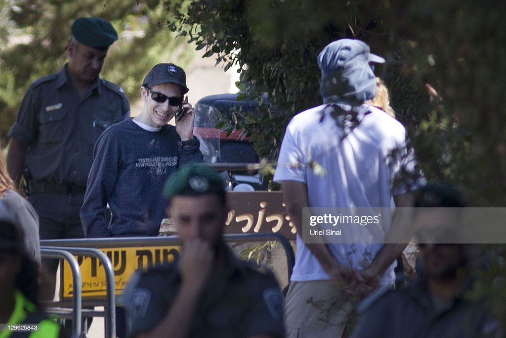 <a gi-track='captionPersonalityLinkClicked' href=/galleries/search?phrase=Gilad+Shalit&family=editorial&specificpeople=537101 ng-click='$event.stopPropagation()'>Gilad Shalit</a> smiles as he talks on a mobile phone outside his home on October 19, 2011 in Mitzpe Hila, Israel. Shalit was freed yesterday after being held captive for five years in Gaza by Hamas militants, in a deal which saw Israel releasing more than 1,000 Palestinian prisoners.