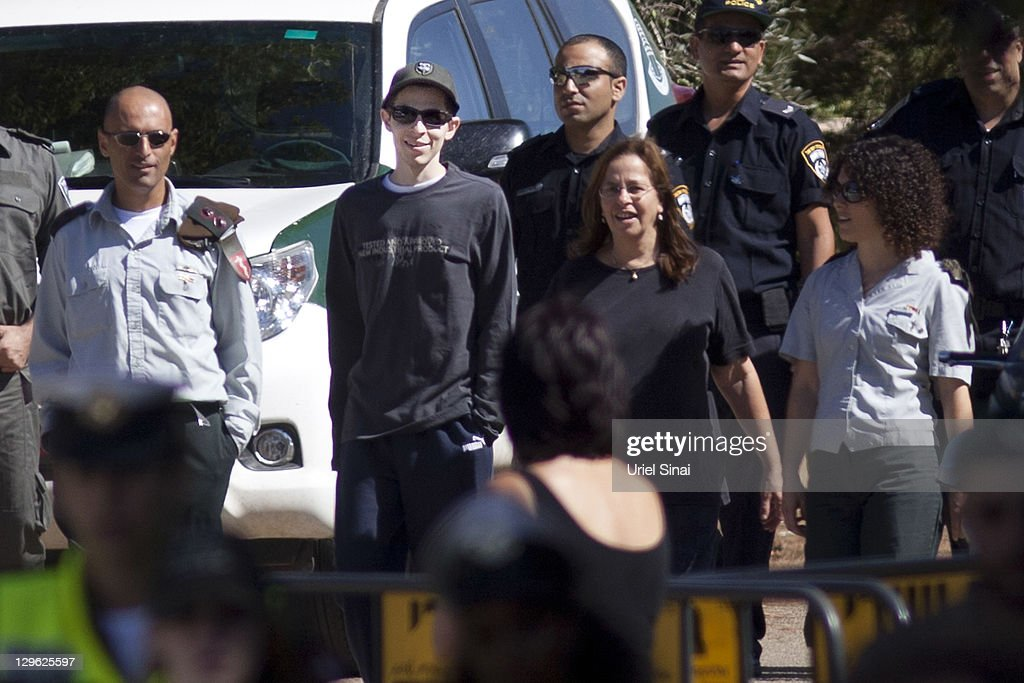 <a gi-track='captionPersonalityLinkClicked' href=/galleries/search?phrase=Gilad+Shalit&family=editorial&specificpeople=537101 ng-click='$event.stopPropagation()'>Gilad Shalit</a> walks with his mother Aviva outside their home on October 19, 2011 in Mitzpe Hila, Israel. Shalit was freed yesterday after being held captive for five years in Gaza by Hamas militants, in a deal which saw Israel releasing more than 1,000 Palestinian prisoners.