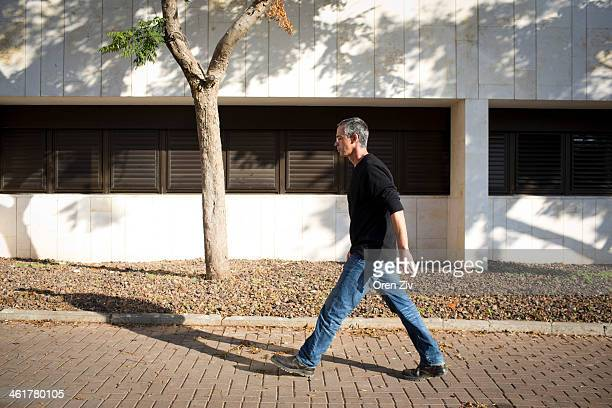 Gilad Sharon the son of former PM Ariel Sharon walks at Tel Hashomer hospital after the hospital announced the death of Ariel Sharon on January 11...