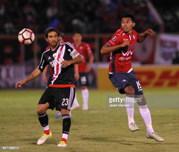 Gilbert Alvarez of Wilstermann and Leonardo Ponzio of River Plate fight for the ball during a first leg match between Wilstermann and River Plate as...