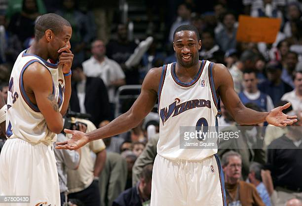 Gilbert Arenas and Antonio Daniels of the Washington Wizards react during game four of the Eastern Conference Quarterfinals against the Cleveland...