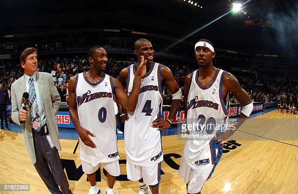 Gilbert Arenas Antawn Jamison and Larry Hughes of the Washington Wizards celebrate a win against the Seattle SuperSonics January 6 2005 at the MCI...