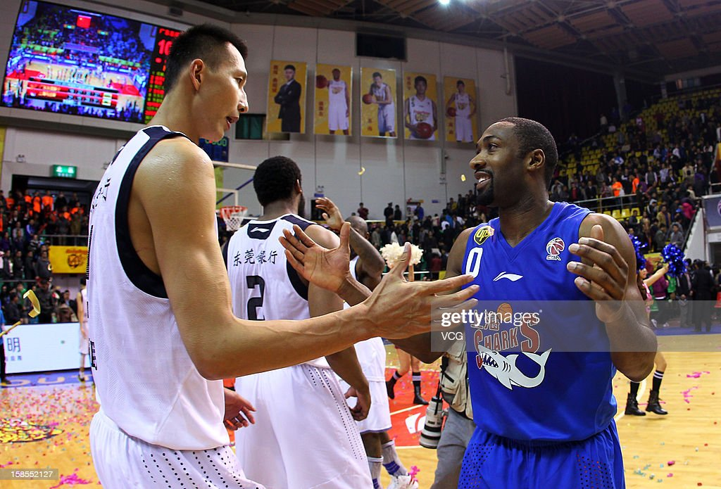 Gilbert Arenas #0 of Shanghai Sharks and Yi Jianlian #9 of Guangdong Southern Tigers high five after the 11th round of the CBA 12/13 game at Dongguan Stadium on December 18, 2012 in Donggang, China.