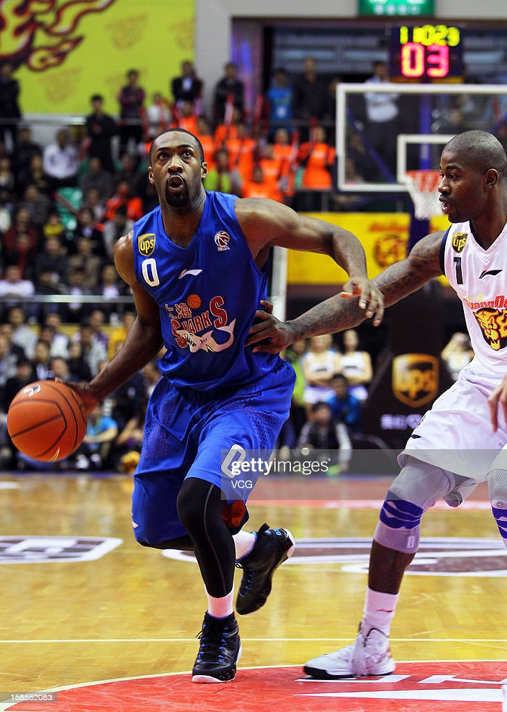 <a gi-track='captionPersonalityLinkClicked' href=/galleries/search?phrase=Gilbert+Arenas&family=editorial&specificpeople=201742 ng-click='$event.stopPropagation()'>Gilbert Arenas</a> #0 of Shanghai Sharks drives the ball during the 11th round of the CBA 12/13 game against Guangdong Southern Tigers at Dongguan Stadium on December 18, 2012 in Donggang, China.