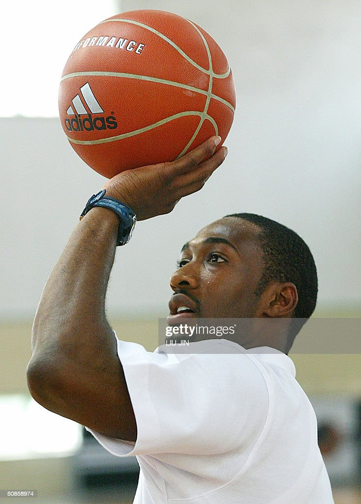 Gilbert Arenas of the NBA Washington Wizards team ahead of a training session of the Adidas Basketball Superstar Camp in Shanghai, 20 May 2004. The camp features NBA players and professional coaches from the US, Europe and China to develop future generations of Basketball superstars. Fifty elite youth basketball players from China, Hong Kong, Australia, Philippines, Korea, Chinese Taipei, Singapore participate the four-day training event. AFP PHOTO/LIU Jin