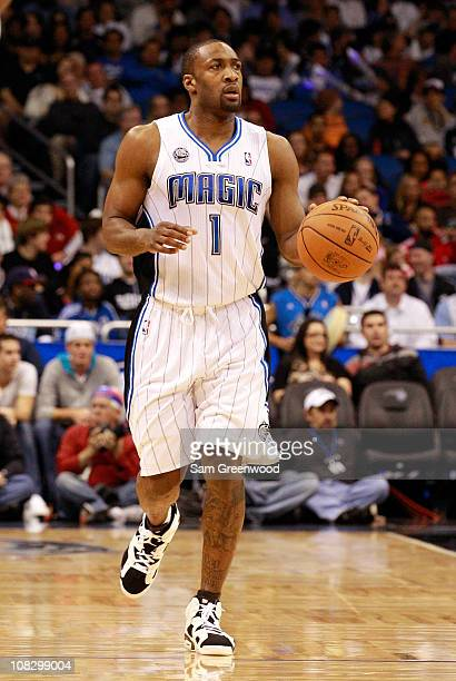 Gilbert Arenas of the Orlando Magic sets up a play during the game against the Detroit Pistons at Amway Arena on January 24 2011 in Orlando Florida...