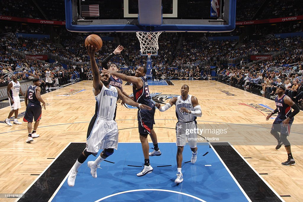<a gi-track='captionPersonalityLinkClicked' href=/galleries/search?phrase=Gilbert+Arenas&family=editorial&specificpeople=201742 ng-click='$event.stopPropagation()'>Gilbert Arenas</a> #1 of the Orlando Magic shoots against <a gi-track='captionPersonalityLinkClicked' href=/galleries/search?phrase=Jason+Collins+-+Basketball+Player&family=editorial&specificpeople=201926 ng-click='$event.stopPropagation()'>Jason Collins</a> #34 of the Atlanta Hawks in Game Five of the Eastern Conference Quarterfinals in the 2011 NBA Playoffs on April 26, 2011 at the Amway Center in Orlando, Florida.