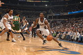 Gilbert Arenas of the Washington Wizards drives to the basket against the Seattle Supersonics during the game November 11 2005 at the MCI Center in...