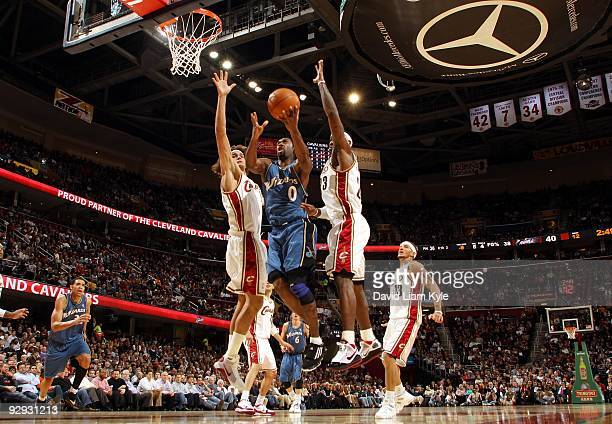 Gilbert Arenas of the Washington Wizards drives to the basket for a layup between Anderson Varejao and LeBron James of the Cleveland Cavaliers during...