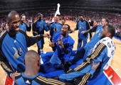Gilbert Arenas of the Washington Wizards gestures in the huddle with teammates before the game against the Philadelphia 76ers on January 5 2010 at...