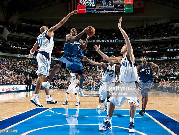 Gilbert Arenas of the Washington Wizards goes in for the layup against Shawn Marion and Dirk Nowitzki of the Dallas Mavericks during the season...