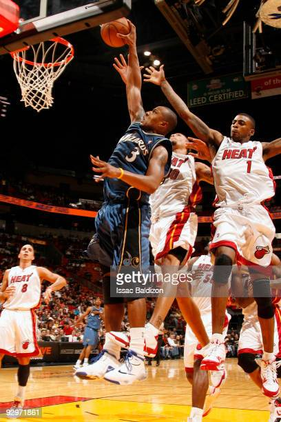 Gilbert Arenas of the Washington Wizards shoots against Dorell Wright of the Miami Heat on November 10 2009 at American Airlines Arena in Miami...
