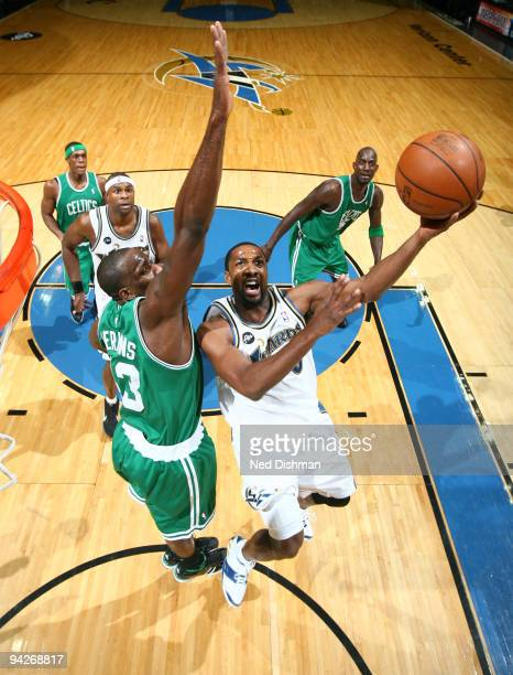 Gilbert Arenas of the Washington Wizards shoots against Kendrick Perkins of the Boston Celtics at the Verizon Center on December 10 2009 in...
