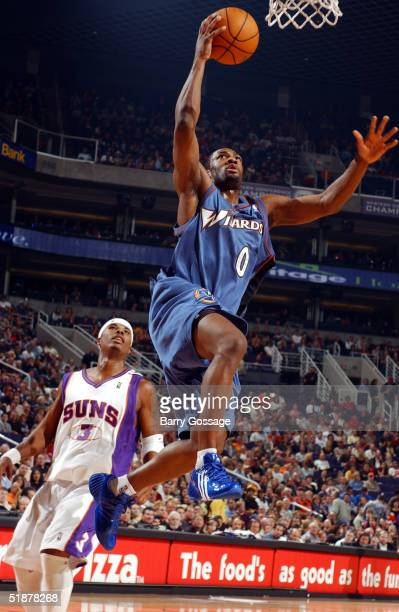 Gilbert Arenas of the Washington Wizards shoots while Quentin Richardson of the Phoenix Suns watches on December 18 2004 at America West Arena in...