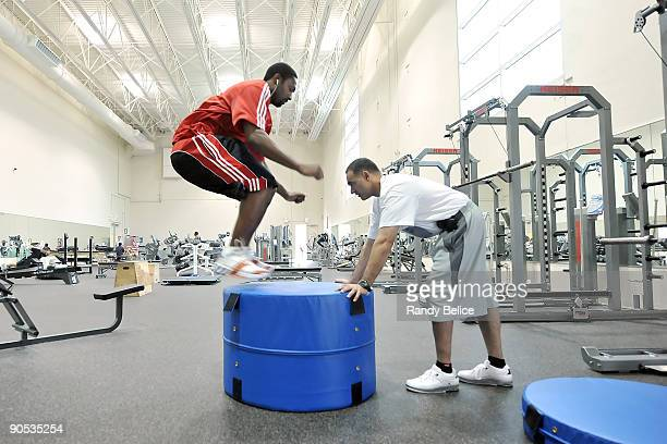Gilbert Arenas of the Washington Wizards who played ony 15 games in the last two seasons does a vertical leap atop a pedestal anchored by Tim Grover...