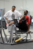 Gilbert Arenas of the Washington Wizards who played ony 15 games in the last two seasons does leg presses while observed by Tim Grover sports...